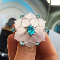 One-of-a-kind Boghossian ring with milky-blue nephrite carved into the shape of a flower - the perfect backdrop for flashes of Paraiba tourmaline. Discover the stylish and asian brand that made its debut at the Biennale in incredible jewellery fashion: http://www.thejewelleryeditor.com/jewellery/boghossian-jewellery-biennale-des-antiquaires-paris/ #jewelry