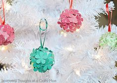 Paper Flower DIY Ornaments | Paper flower crafts never looked so good on a Christmas tree!