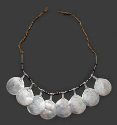 Morocco | Necklace; silver and black stone beads on a natural fibre cord | Est. 300-400€  (Feb '14)