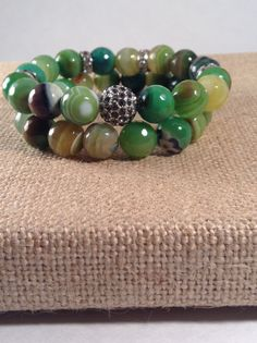 Gorgeous green agate stretch bracelet set with pave accent bead. By Vella&Ro House of Jewelry.
