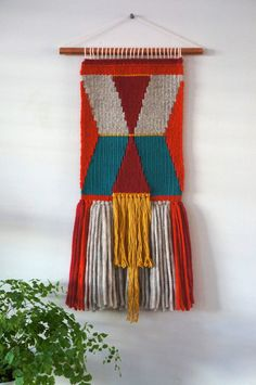 If you want a $600-cheaper alternative than the Anthropologie woven wall hangings, look to Lepetitmoose on Etsy!