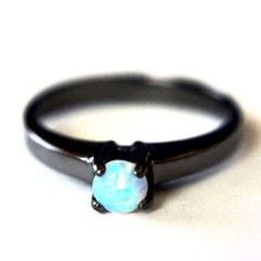 ETHIOPIAN OPAL SOLITAIRE RING