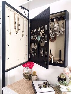 Love the idea of the swinging peg board... Wall Mounted Jewelry Organizer Photo Frame by bleachla on Etsy