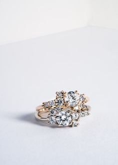 Our Diamond Cluster engagement ring features a prong set cluster of 7 ethically sourced round white diamonds. All our jewelry is handcrafted in Philadelphia using conflict free materials.