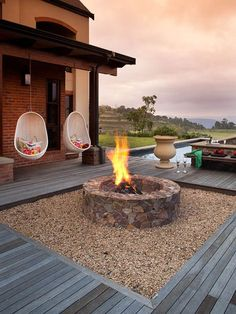 Sitting around an outdoor fire pit with loved ones, gazing at the warm flames under the starry night sky, life is just blissful and magical! As a home and garden designer, I see fire pit on almost … Diy Fire Pit, Fire Pit Backyard, Fire Pits, Outdoor Living Areas, Outdoor Spaces, Outdoor Decor, Fire Pit Materials, Fire Pit Furniture, Outdoor Furniture