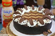 Chocolate Peanut Butter Cheesecake - whole cheesecake with peanut butter cup creamer in background   From SugarHero.com