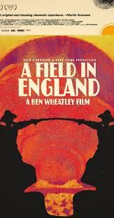 a field in england. This is in the footsteps of The Wicker Man, Witchfinder General, Culloden, The Song Remains The Same, and Penda's Fen. It is very British in that sense. Out in the country, lost, and confused, and then becoming part of the earth itself by consuming loads of magic mushrooms.