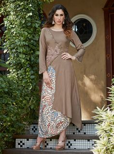 Acquire this idealized beige asymmetric angrakha designer kurti for palazzo. This printed tunic contains trendy sleeves, scoop neckline & embroidery work. Pakistani Dresses, Indian Dresses, Indian Outfits, Stylish Dresses, Casual Dresses, Fashion Dresses, Hijab Casual, Designer Sarees Wedding, Designer Dresses