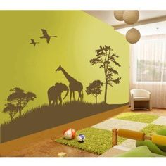 African safari wall decal -  I ended up doing something with the same effect as this. I chose a silhouette after googling images, used a projector to project it on the wall, traced the silhouette with pencil, then finally painted it in with regular wall paint. Super easy and it looks great and only cost as much as a small can of paint. #Cake