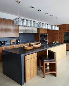 charcoal grey and timber kitchen by Amy Lau Design - love that the bar stools tuck under the countertop and look like cabinet doors. Timber Kitchen, Farmhouse Kitchen Cabinets, New Kitchen, Kitchen Dining, Kitchen Decor, Black Kitchens, Home Kitchens, Kitchen Black, Kitchen Island Lighting