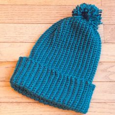 This Christmas, crochet a beautiful ribbed pom pom hat for a friend or family member!looks to be the easiest one for new crochet-ers