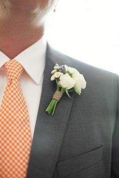 mini-bouquet boutonnieres! Have your man match you! (runculus and wax flower)