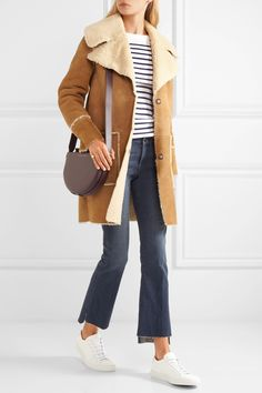 Tan and ecru shearling Concealed snap fastenings along front 100% shearling Specialist clean