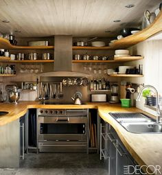 the open shelves keep this tiny kitchen from seeming even smaller. great looking space.