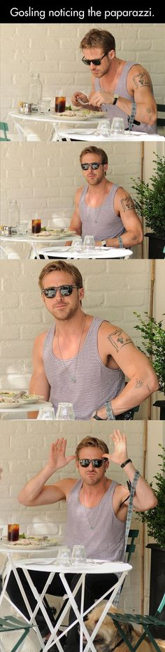 RYAN GOSLING NOTICING THE PAPARAZZI.