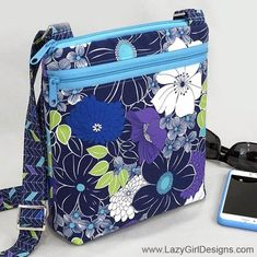 Leave the kitchen sink at home! Whether you are going around the block or across the world, the Lexi Carryall smart crossbody bag with adjustable strap carries all you really need to travel light in style.   #LazyGirlDesigns #CrossBodyBag Bag Patterns To Sew, Sewing Patterns, Halloween Taschen, Lazy Girl Designs, Small Zipper Pouch, Carry All Bag, Crossbody Bag, Tote Bag, Leather Crossbody