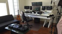 Nothing fancy going on in this clean, light-filled studio—oh, except for all that equipment and that huge DIYed desk.