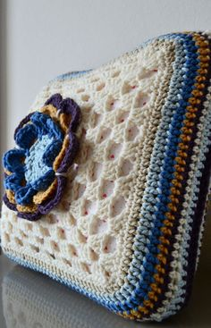 crochet pillow cover with flower