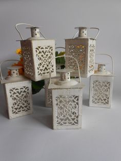 Set of 6 Mini Lanterns,Wedding Candle Holders, Wedding Centerpiece ,Moroccan Mini Lanterns ,Rustic Lantern,Home Decor,Vintage Lantern  Our Mini Lanterns is the perfect wedding favor for your wedding guests to leave them with a lasting impression.  These glass and metal mini lanterns will bring a soft romantic glow to your wedding reception or party. If you're having an outdoors wedding, string the lanterns in trees for a look straight out of a fairy tale. A mini lantern makes a great table…