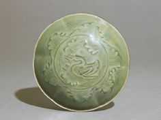 Greenware bowl with ducks amid wavestop