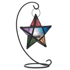 "Evening Star Standing Lantern. Suspended from a slender curlicue of wrought iron a multicolored star casts a halo of carnival splendor! A unique tabletop candle lamp that enlivens your next gathering with a festive glow.    Weight 1.4 lbs. Iron and glass. Tealight candle not included. Lantern: 7 1/2"" x 2"" x 8"" high; stand: 14"" high."