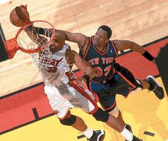 Patrick Ewing attempts to block Alonzo Mourning during Game 1 of the 2000 NBA Eastern Conference Semifinals between the Knicks and Heat. New York would go onto win the series in seven games.