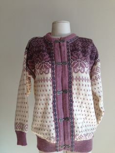 This is a vintage 1980's Dale of Norway cardigan sweater.