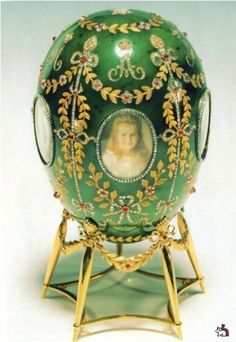 Faberge Egg in green enamel, with precious jewels and photographs.