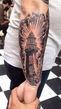 Lighthouse tattoo artist @tattoo_by_ibo