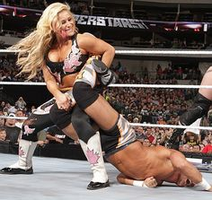 Natalya with a sharpshooter on Tyson Kidd. Haha love this because that's her husband!