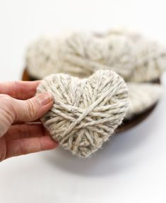 Yarn wrapped hearts. Neutral Valentine's Day decor ideas with yarn wrapped hearts. Valentine craft idea with yarn. How to make yarn wrapped hearts for Valentine's Day.