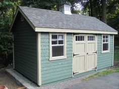 pictures of yellow sheds with flower boxes | 10' x 16' with Amish Mike Green body, New Holland beige trim, Harvard ...