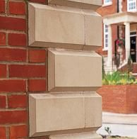 Home with precast concrete window surrounds quoins and for Brick quoin detail