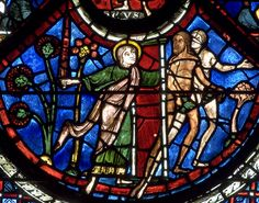 Chartres ~ Centre-Val de Loire ~ France ~ Notre Dame Cathedral ~ An angel with a flaming sword casts Adam and Eve out of Paradise.