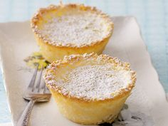 Sweet and satisfying, these little baked coconut custard tarts have the added nutty depth of both shredded and desiccated coconut, plus a dash of lemon zest. Tart Recipes, Sweet Recipes, Baking Recipes, Dessert Recipes, Uk Recipes, Simply Recipes, Coconut Recipes, Coconut Tart, Coconut Custard