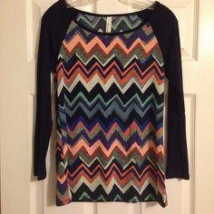 Chevron Striped Colorful Top Brand new super cute chevron striped top. Sleeves are navy blue. 95% rayon, 5% spandex. Tops Blouses