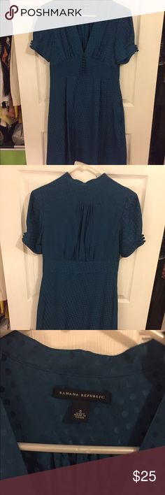 Banana Republic Vintage Style Silk Dress Deep teal silk material makes this vintage style Banana Republic dress even prettier. The material has a dot pattern. Covered button accents, v-neck, and hits at the knee. Great for date night! EUC Banana Republic Dresses