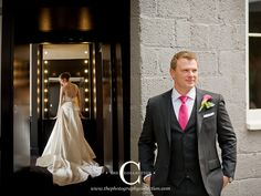 The Collection - Long-train wedding dress, with groom in a black tux with pink accents in the tie and boutonniere  http://www.thephotographycollection.com/