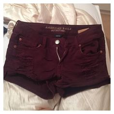 Maroon Ripped Low Rise Jean Shorts ❤ liked on Polyvore featuring shorts, ripped jean shorts, jean shorts, distressed shorts, denim short shorts and destroyed shorts