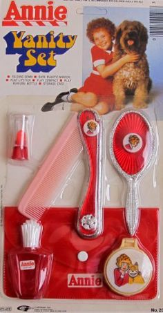 Little Orphan ANNIE VANITY SET 6 Pieces CHILD SIZE w Folding COMB, Make UP Case & MORE (1981) by Gordy International, made in Hong Kong. $89.99. All sizes, colors & details are provided to the best of my ability & may not be exact & may vary.. * Package has minor shelf wear, some surface creases & small tear on front; plastic slightly yellowy. For Package Condition see CONDITION NOTE or Email Seller for Details.. For Ages 4+ Years. VINTAGE HARD TO FIND Orphan Annie Vanity Set!...