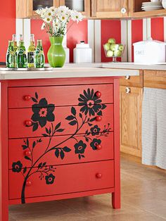 build your own kitchen island by putting two dressers back to back and attaching a door to the top