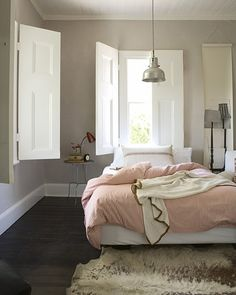 Tranquil, unfussy bedroom with dark hardwoods.