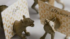 do it yourself video tutorial for golden animal wedding place card holders.