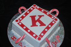 Kappa alpha psi cake with fondant canes