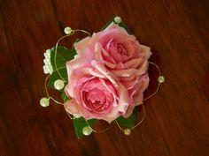 Pink spray rose wrist corsage on a beaded wristlet