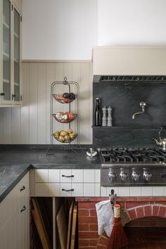 """The brick arch under the range was one of the only elements remaining from the original kitchen that we kept and integrated into our design,"" Sherwood says. Soapstone Kitchen, Soapstone Countertops, Black Countertops, Kitchen Countertops, Kitchen Cabinets, Countertop Backsplash, Kitchen Island, Ikea Kitchen, Rustic Kitchen"
