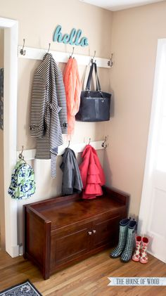 Create an organized entryway in place of a hall closet or mudroom Using wall for 2 rows of hooks & small chest, maybe a mirror and smaller hooks for keys on the other wall