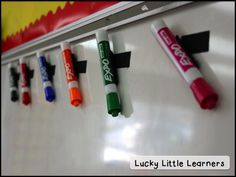 """Diggin' into Next Year: Classroom Organization - Lucky Little Learners I like to store my Expo markers directly on my markerboard attached to  velcro. Why? A few reasons…I like that they are up high so my students  aren't constantly grabbing and """"forgetting"""" to return them. I also  like where they are placed because they are quick and handy to grab when  I need them. I always hang them up with the tip facing downwards too  because it leaves me with a longer-lasting marker."""