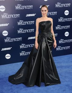 """Angelina Gets Dramatic in Versace—Continuing the trend of wearing Versace on the red carpet, Angelina Jolie took her villainous role as dressing inspiration for the """"Maleficent"""" world premiere held in Hollywood last night. The actress wore a strapless black gown made of rubberized silk. It's certainly a bold look–and while on the subject of dramatic...[Read More]"""