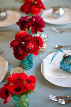 We love the monochromatic look and feel of beautiful florals....so, for this shoot, we used red ranunculus and red anemones....and my floral friend Holly of Holly Heider Chapple Flowers came to visit me on the day of the shoot and she brought the most beautiful deep burgundy peonies....the reds looked so pretty with all the teal vases and the pretty blue ornaments from Home Goods.